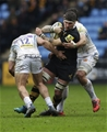 COVENTRY, ENGLAND - FEBRUARY 18: Guy Thompson of Wasps tackled by Don Armand (r) and Sam Hill of Exeter Chiefs during the Aviva Premiership match between Wasps and Exeter Chiefs at The Ricoh Arena on February 18, 2018 in Coventry, England. (Photo by Henry Browne/Getty Images)
